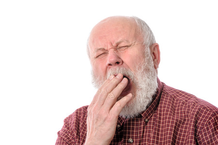 Senior man yawning, isolated on white Stock Photo