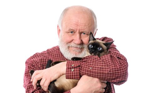 Cheerfull senior man with cat isolated on white