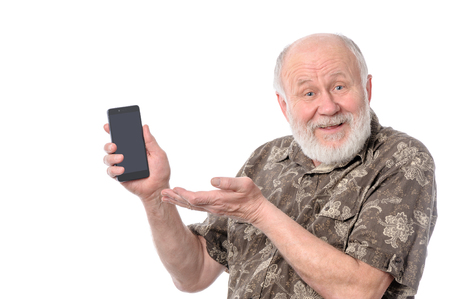 senior man showing something at smartphone screen, isolated on white
