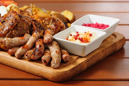 multiple objects: Big grilled meat and vegetables board