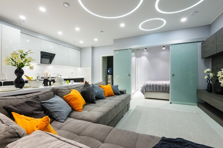 Modern white living studio with bedroom doors open