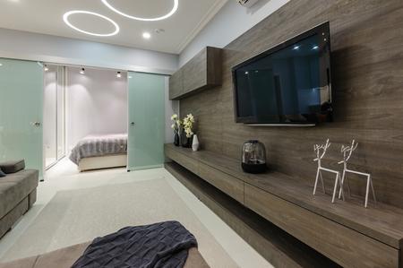 Modern designer white living studio with bedroom doors open