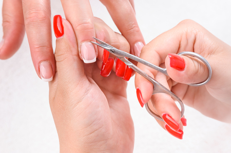 Cuticles cutting with scissors Stock Photo