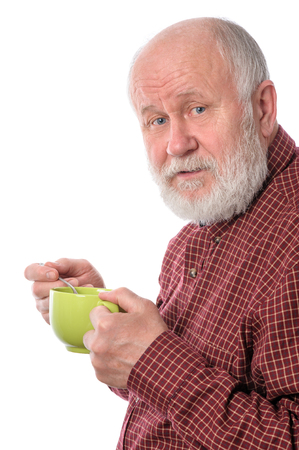 Cheerfull senior man with green cup, isolated on white
