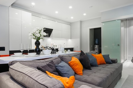 Modern white living studio with bedroom doors open
