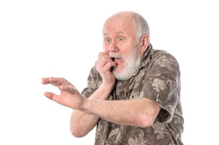Senior man with grimace of fear, isolated on white Stock Photo