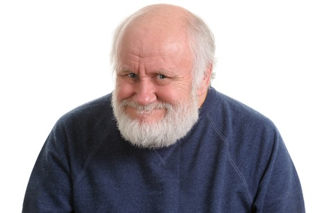 old man with insidious tricky fake smile, isolated on withe