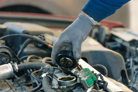 engine oil changing at car with liquefied petroleum gas system Stockfoto