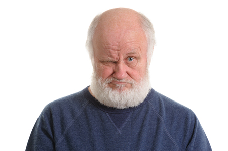 dissatisfied displeased old grumpy man isolated portrait
