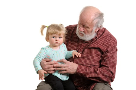 Old good grandpa and his little granddaughter