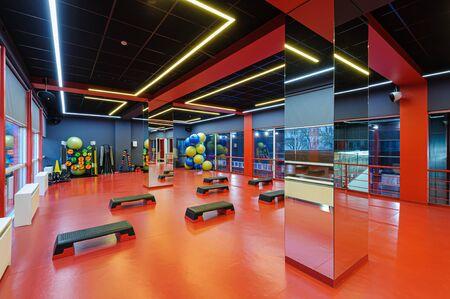 Aerobics gym room interior with step decks
