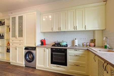 modern cream colored kitchen interior