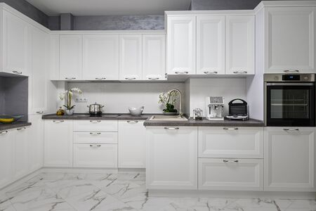 Clean and minimalistic modern white kitchen interior