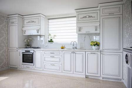 Luxury modern classic white kitchen interior 免版税图像