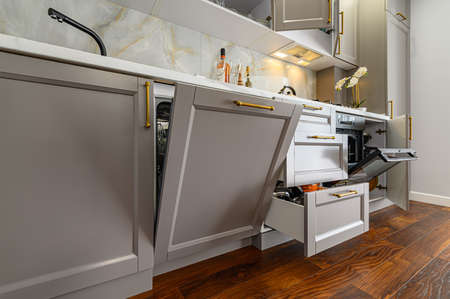 Closeup details of grey and white modern classic kitchen, all doors are open