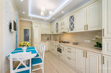Beige, white and cyan furniture at kitchen in provence style,
