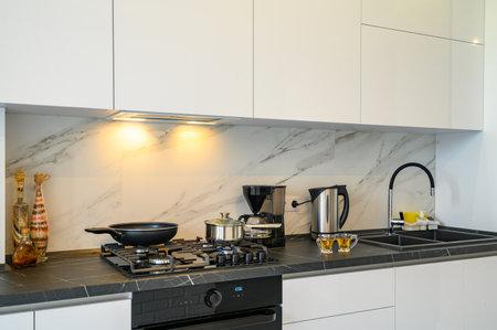 Closeup to modern kitchen cupboard