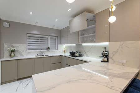 Luxury white modern marble kitchen in studio space