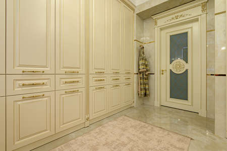 Modern luxury beige and golden bathroom