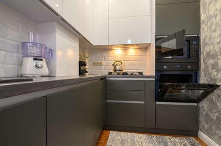 Modern dark grey small kitchen interior