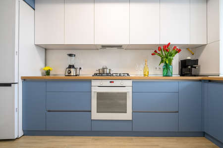Modern blue-teal kitchen interior, furniture front view