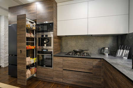Modern luxury large dark brown, gray and black kitchen details