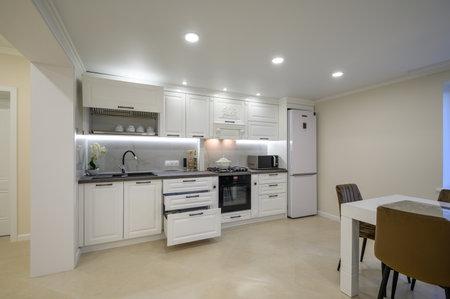 Modern luxurious white kitchen interior Foto de archivo