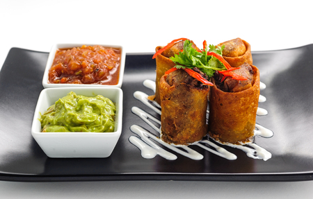 Springroll - traditional Asian appetizer on a plate photo