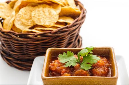 potatoe: A wicker basket with potatoe chips isolated