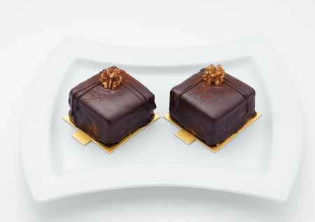 Chocolate sponge cakes on white plate photo