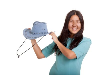 specialize: Oriental girl posing in studio with cowboy hat Stock Photo
