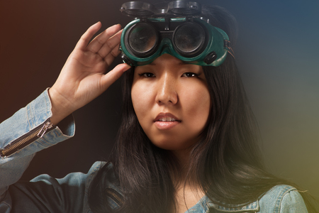 pocahontas: Oriental girl posing in studio with wleding goggles