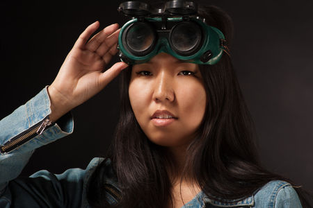 specialize: Oriental girl posing in studio with wleding goggles