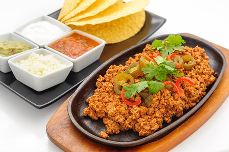 flapjacks: Fried minced beef on hot plate with sauce and crispy flapjacks Stock Photo