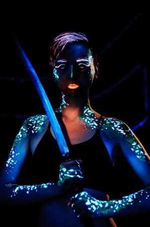 bodyart: Girl with neon paint bodyart portrait, studio shot