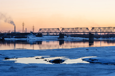 novosibirsk: Railroad bridge and construction site on river bank in the sunset Stock Photo