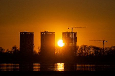 novosibirsk: Construction site on river bank in the sunset