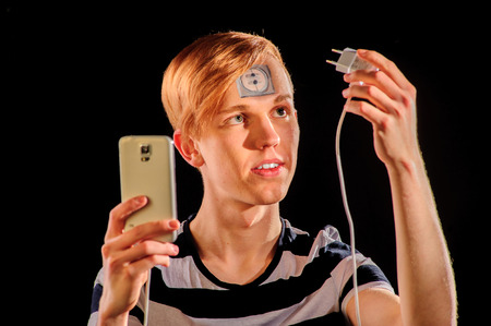 bodyart: Young man with body-art and mobile phone Stock Photo