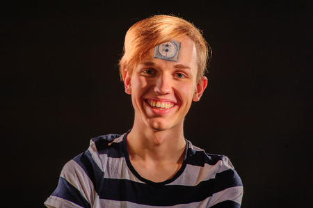 bodyart: Young man with body-art on forehead