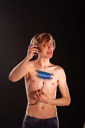 bodyart: Young man with body-art as radio scale on chest Stock Photo