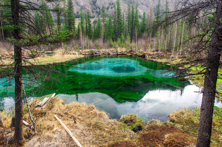 ulagan: Geyser lake in Altai mountains in early spring