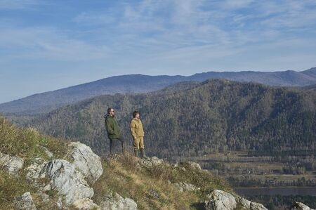 ulagan: Two scientists standing on top of a hill in Altai