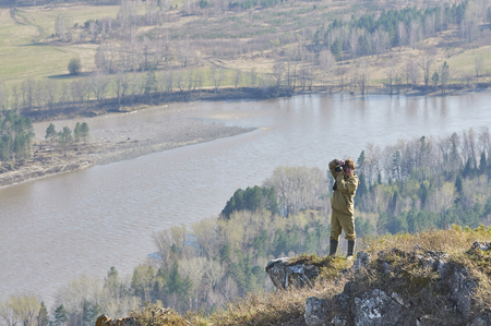 ulagan: Scientists photographer standing on top of a hill in Altai