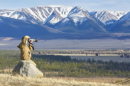 ulagan: Photographer taking pictures of a mountain chain in Altai