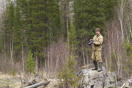 ulagan: Photographer near a geyser lake in Altai Stock Photo