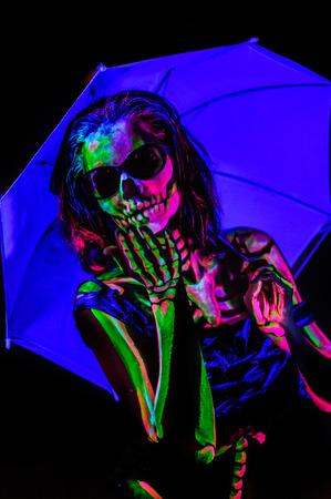 bodyart: Skeleton bodyart with blacklight studio portrait Stock Photo