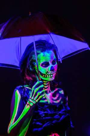 Skeleton bodyart with blacklight studio portrait Stock Photo