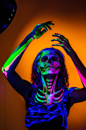 picknick: Skeleton bodyart with blacklight studio portrait Stock Photo