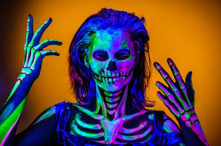 kidding: Skeleton bodyart with blacklight studio portrait Stock Photo