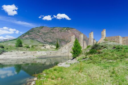 uncomplete: Uncomplete construction site in mountain valley in Altai in summer